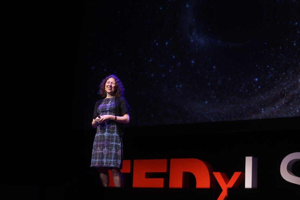Dr. Gabriela Gonzálezwearing the LIGO dress! Photo via TEDxLSU.
