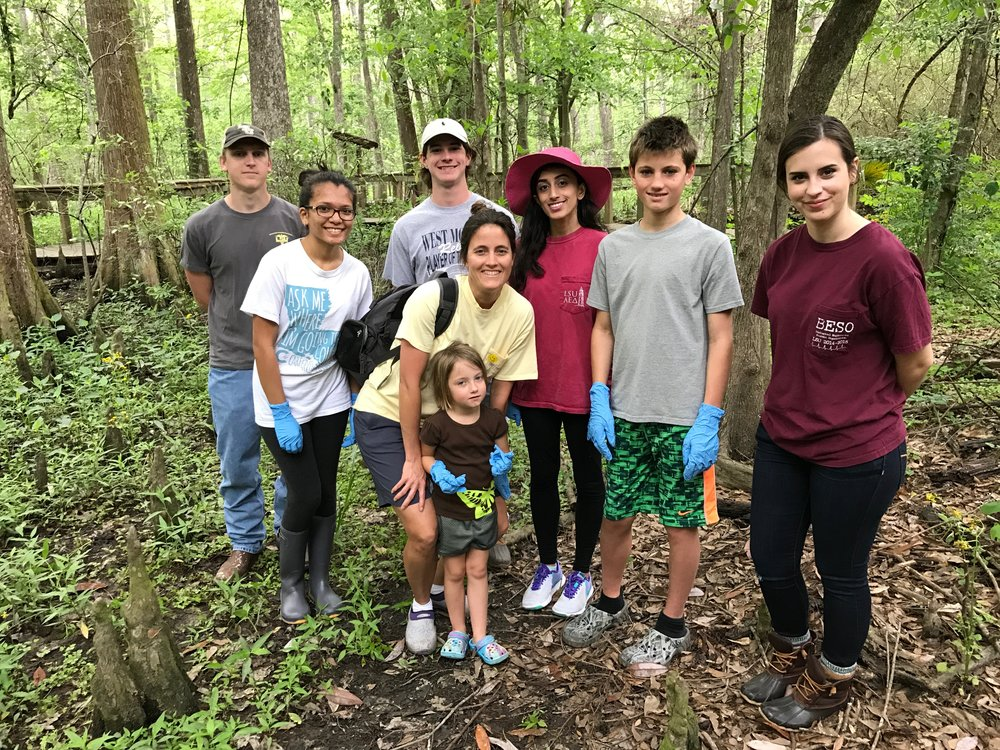 A crew of Biology 2051 students collects samples at Bluebonnet Swamp for microbial analysis with Ginger Brininstool, her daughter (front center) and her son. Photo compliments of Gary King.