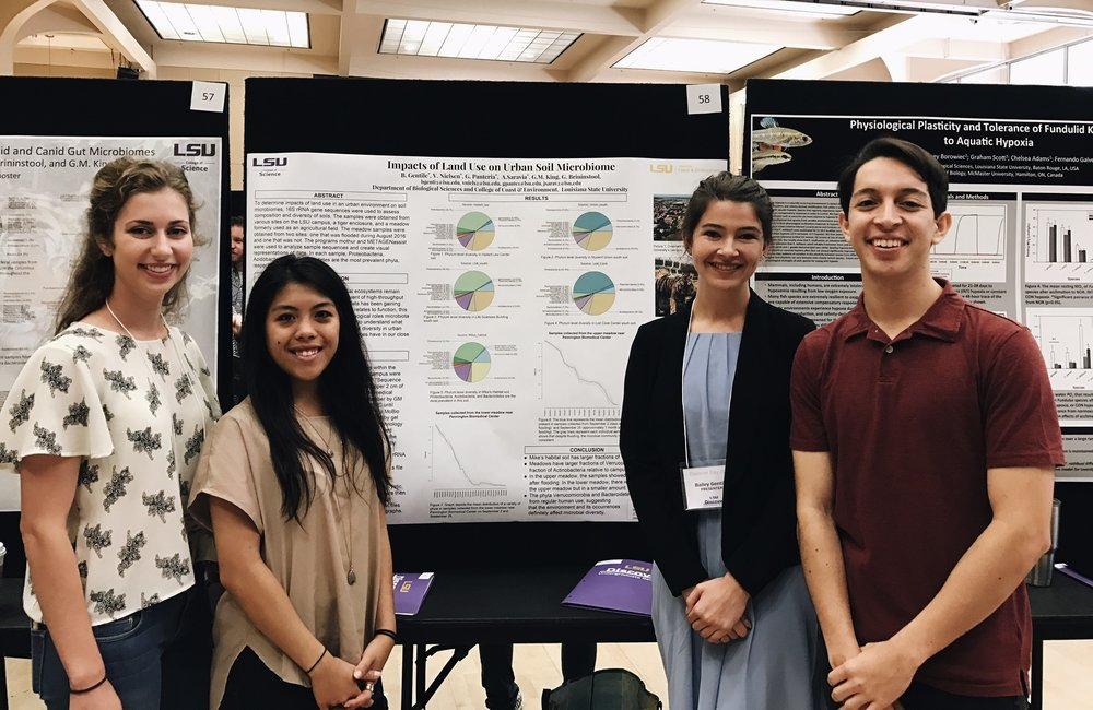 Ari Saravia (right) and his research group members (right to left) Bailey Gentile, Gabrien Panteria and Victoria Nielson at LSU Discover Day.