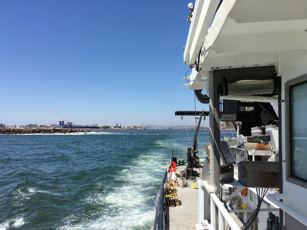 Port is now behind us! The  R/V Oceanus  and crew is headed to sea. - Mike Henson