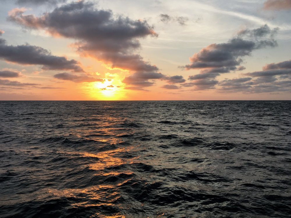 Photo of a beautiful sunset from aboard the  R/V Oceanus . Credit: Mike Henson.