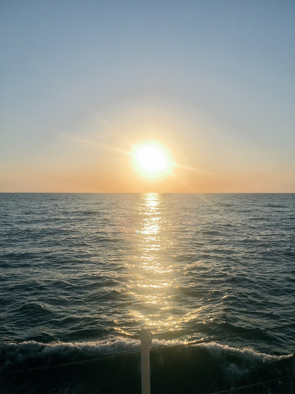 Photo of a sunset from aboard the  R/V Oceanus . Credit: Mike Henson.