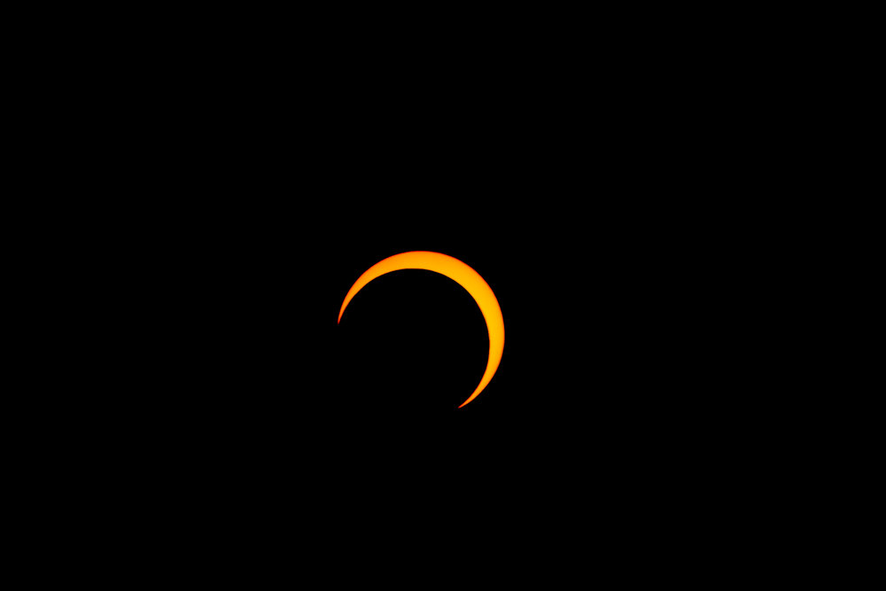 Photo of a partial solar eclipse during annular  solar eclipse of May 20, 2012 . Photo via Wikimedia Commons, Thephatphilmz.