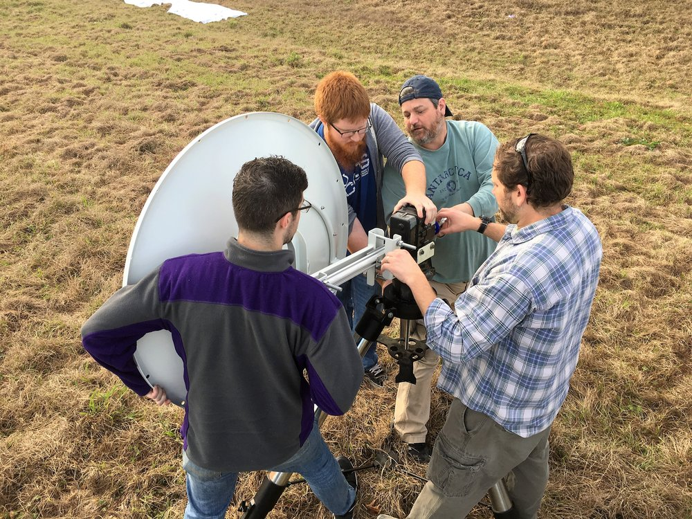 Image taken during the February 2017 Test Flight in Jackson, LA, showing LSU students and staff assembling the Solar Eclipse Balloon Ground Station for testing. Photo Credit: C. Fava, LaSPACE.