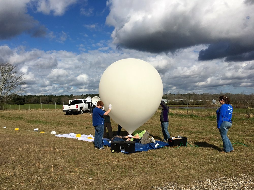 Photo taken during the February 2017 Test Flight in Jackson, LA, showing the LSU Solar Eclipse Balloon Project team inflating the balloon for flight. Students have to wear gloves to avoid static electricity on the balloon, and prevent popping! Photo Credit: C. Fava, LaSPACE.