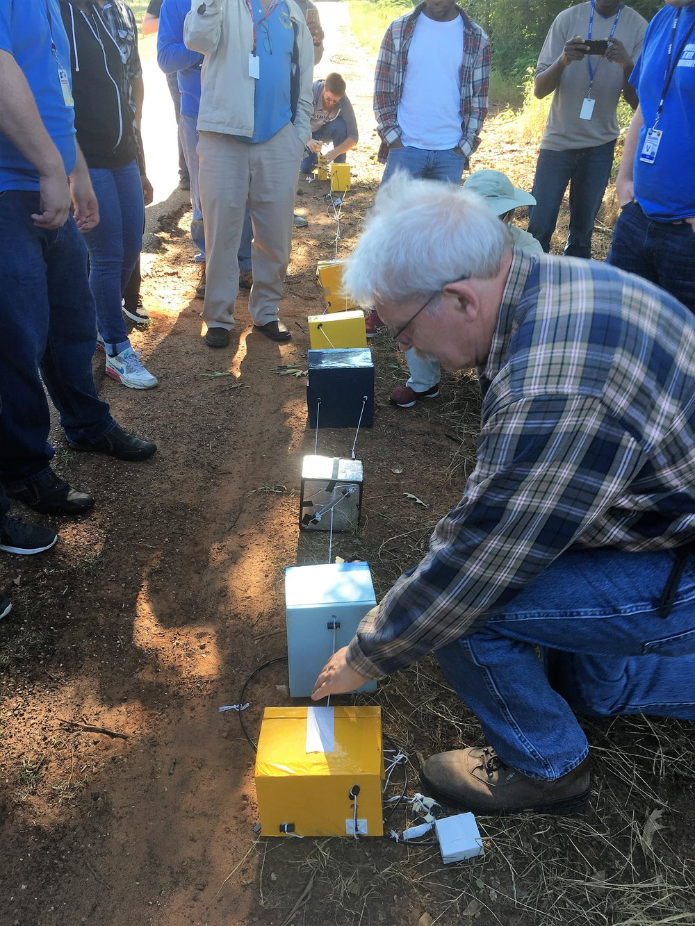 Photo of LaSPACE Director Gregory Guzik laying out a balloon string after the recovery of a test balloon, to return payloads [boxes containing equipment or scientific experiments] to LaACES student teams during the Palestine, TX ballooning competition. Photo Credit: C. Fava, LaSPACE