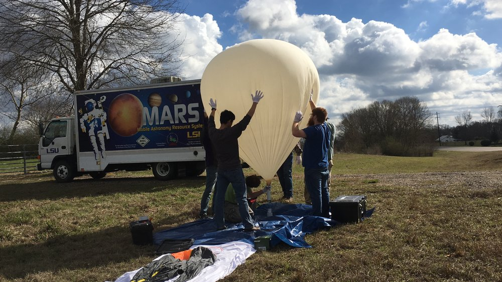Photo of test eclipse balloon launch, with Mars truck in the background! Photo Credit: C. Fava, LaSPACE.