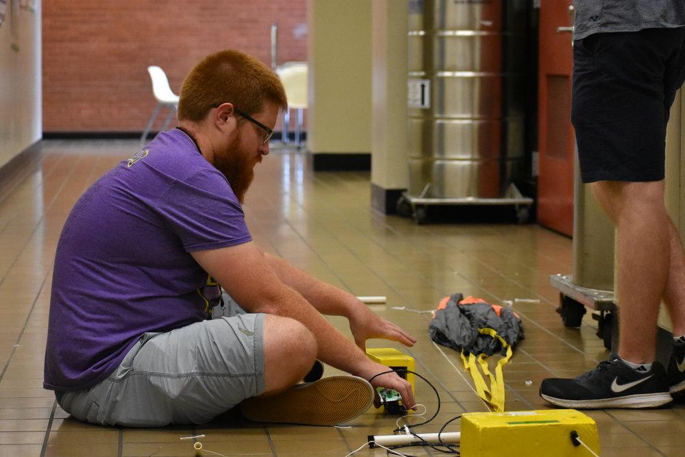 Brad Landry prepares flight string