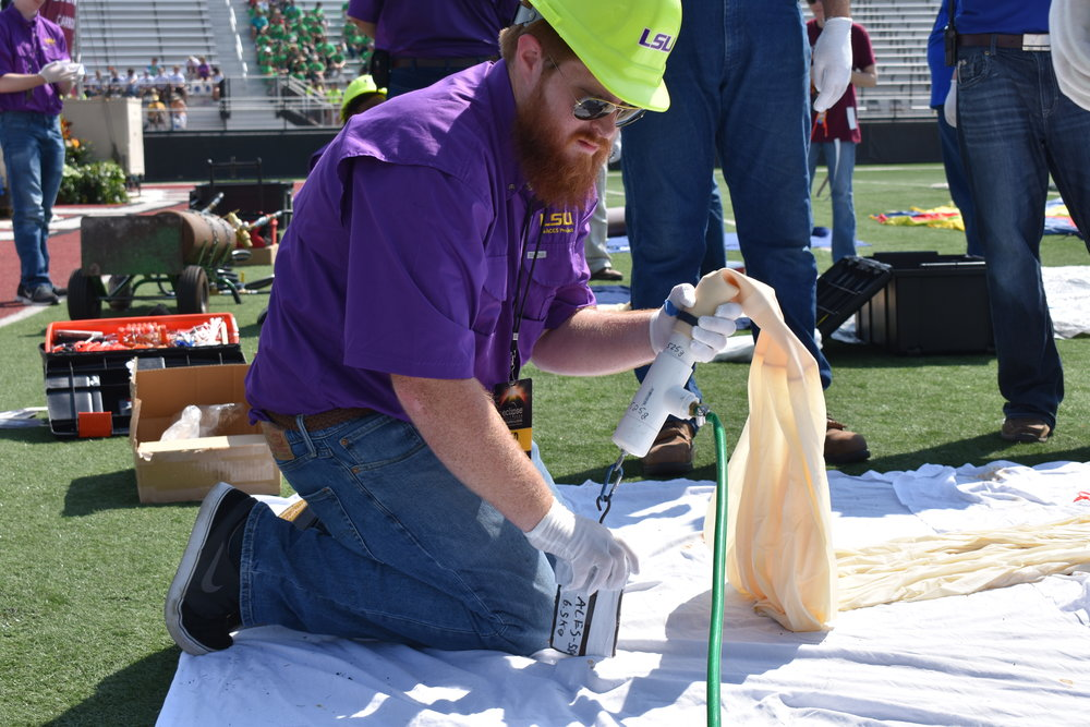 Brad Landry starting to fill the LSU Eclipse Balloon. Credit: Nicki Button.