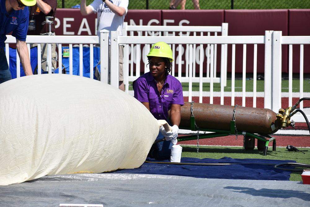 Blair filling a balloon