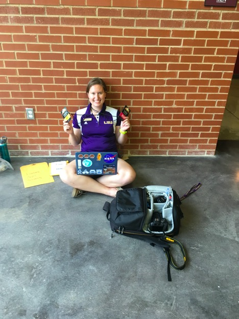 Nicki Button with media and VIP credentials for the eclipse event in Saluki Stadium.
