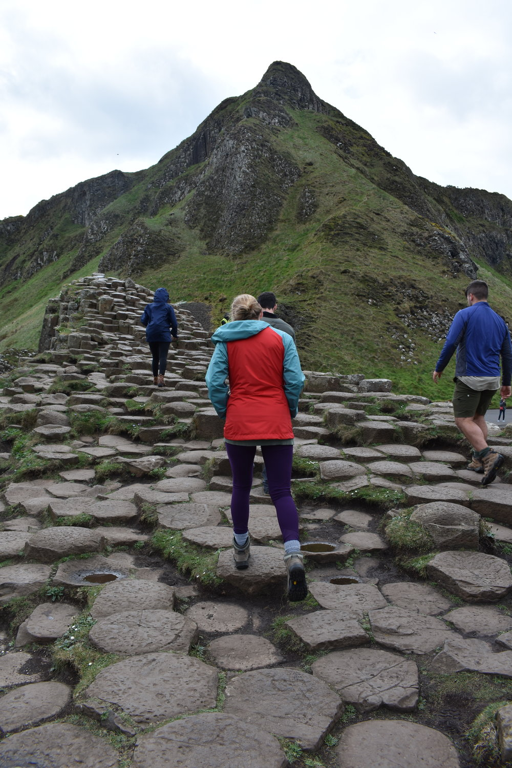 Nikki Neubeck walking on the hexagonal columns at Giant's Causeway. Photo Credit: Nicki Button