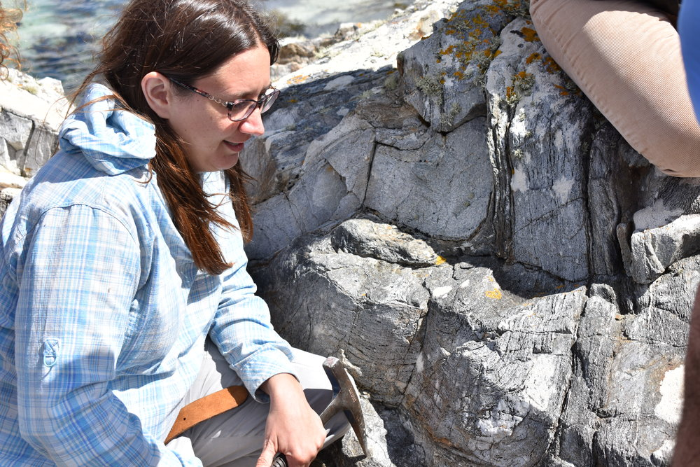 Dr. Amy Luther teaching about the folds (u-shaped feature in the outcrop).  Photo Credit: Nicki Button