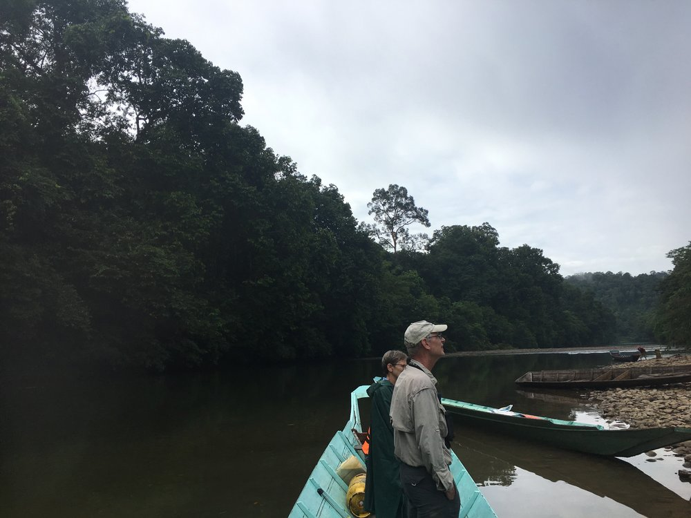 Traveling by boat to the Lanjak Entimau Wildlife Sanctuary in Sarawak, Borneo. Photo via Vivien Chua.