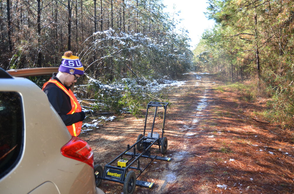 Preparing for a GPR survey of a potential subsurface crater site in Louisiana. Credit: Don Hood.