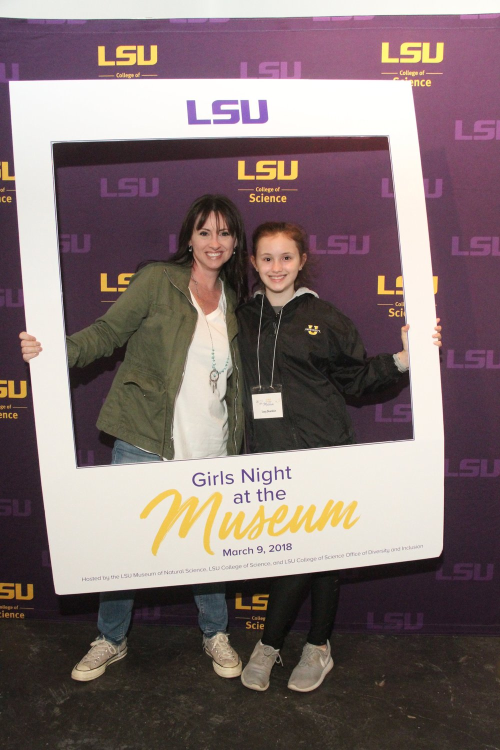 Izzy and her mom commemorate the night at the Girls Night at the Museum photo booth. Say Science!