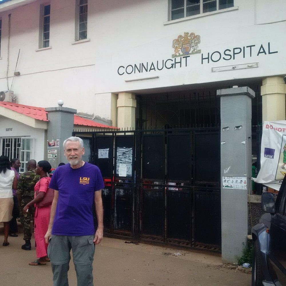 Jim Lange in front of Connaught Hospital in Sierra Leone.