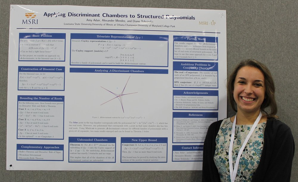 Amy Adair giving a poster presentation.