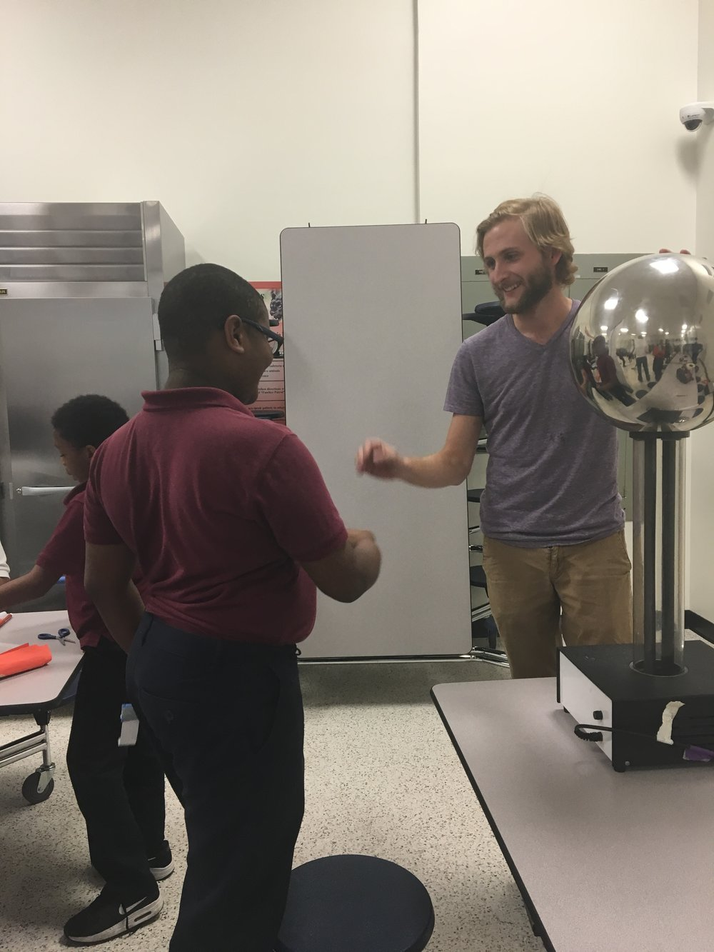 Anthony Ficklin conducting a physics demonstration.