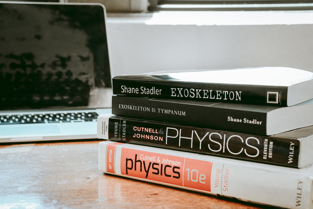 "Beyond the books in his ""Exoskeleton"" series, Shane Stadler has frequently been the author of physics textbooks. Credit: Jessica Manafi"