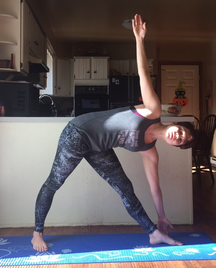 Triangle pose- being mindful to not collapse in my shoulders, neck or side body.