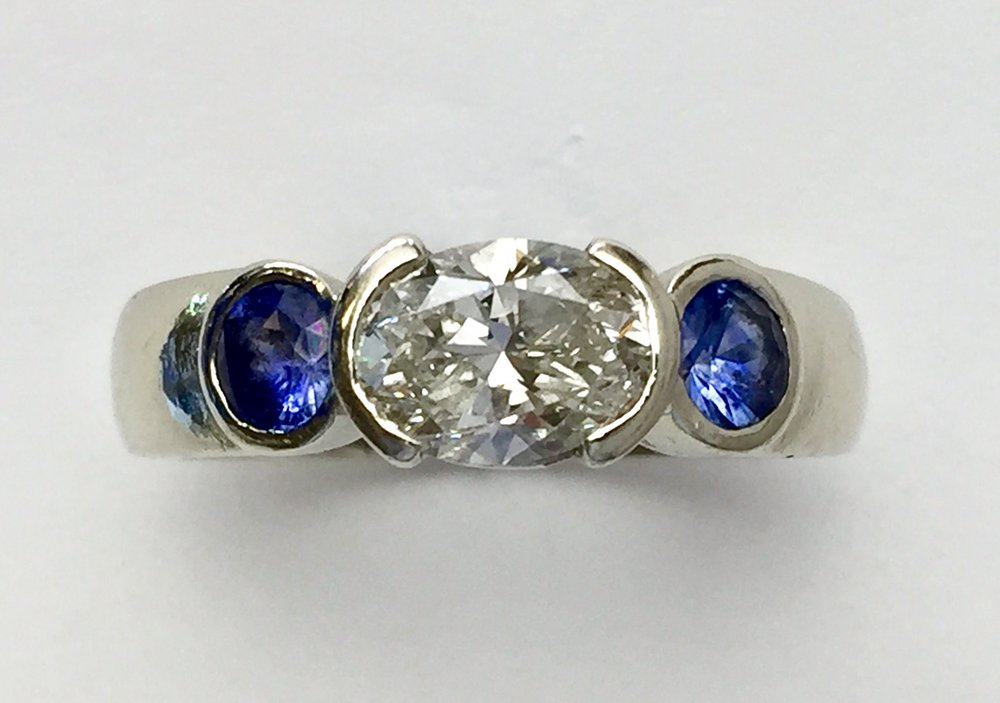 Another conversion of an oval diamond engagement ring to everyday ring, with a splash of color!
