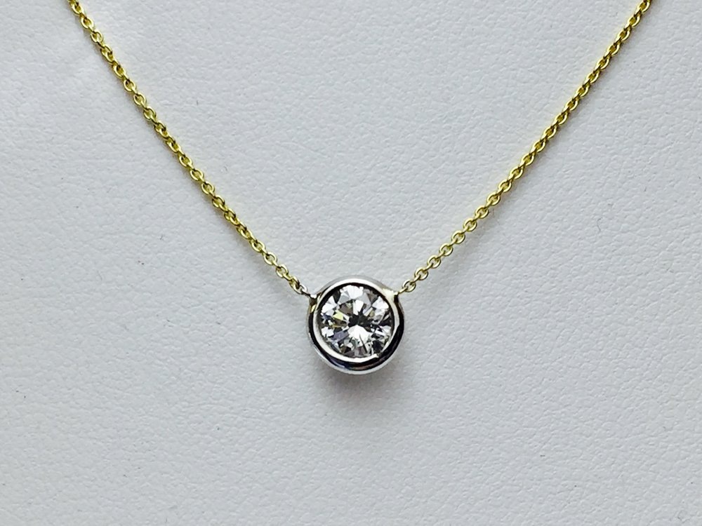 Repurpose a diamond into a stunning bezel set necklace! Yellow gold, white gold or two tone.