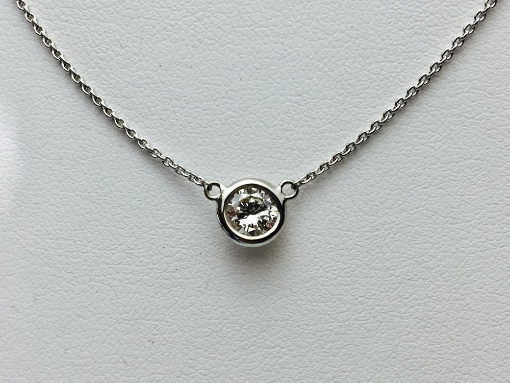 Single earrings make beautiful pendants! This one shown in 14k white gold.