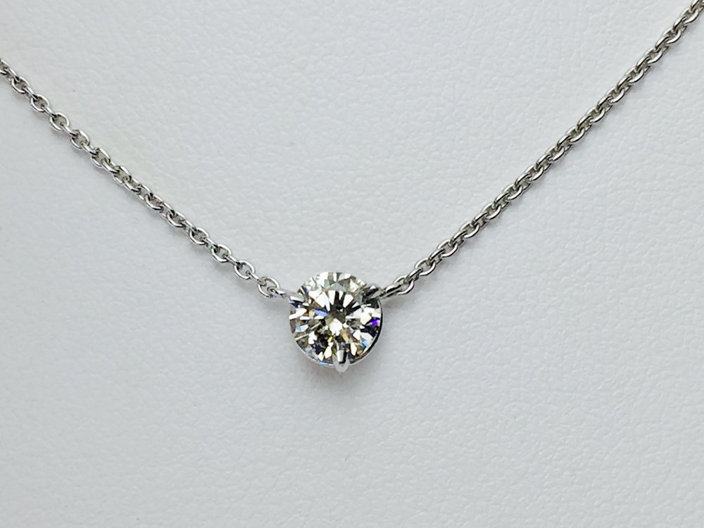 Three prongs and no bezel turn this diamond into a simply sparkling necklace!