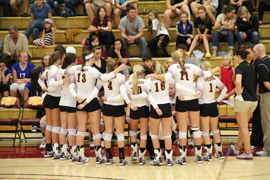 The Bulldog volleyball team talks strategy during a timeout in their three-set sweet over Minnesota-Crookston on Thursday. MADDIE GINSBERG/STATESMAN