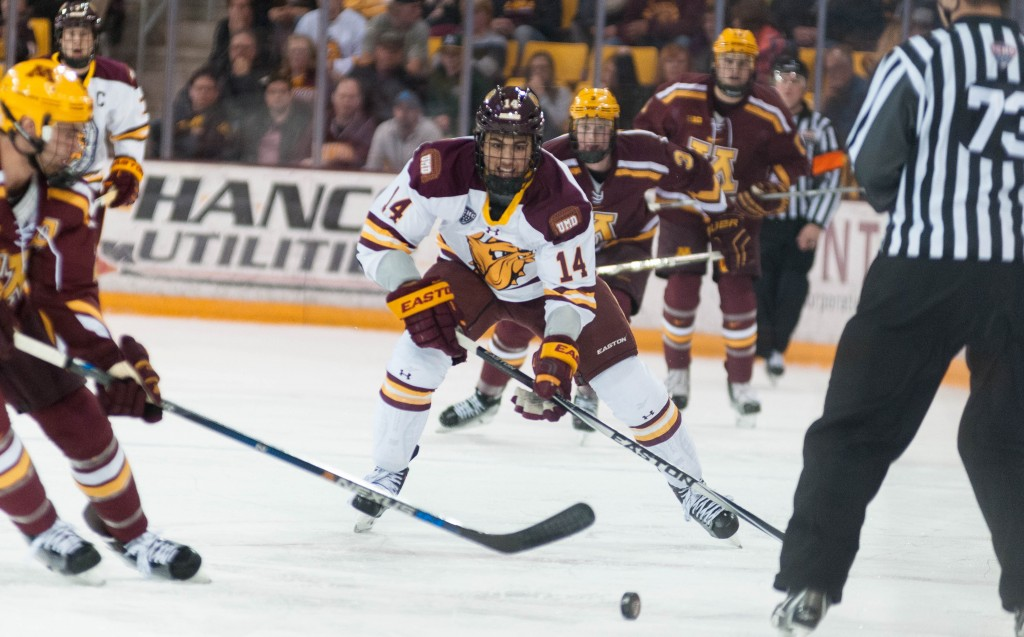 Alex Iafallo chases a loose puck in tonight's win over the Gophers. ALEX GANEEV/STATESMAN