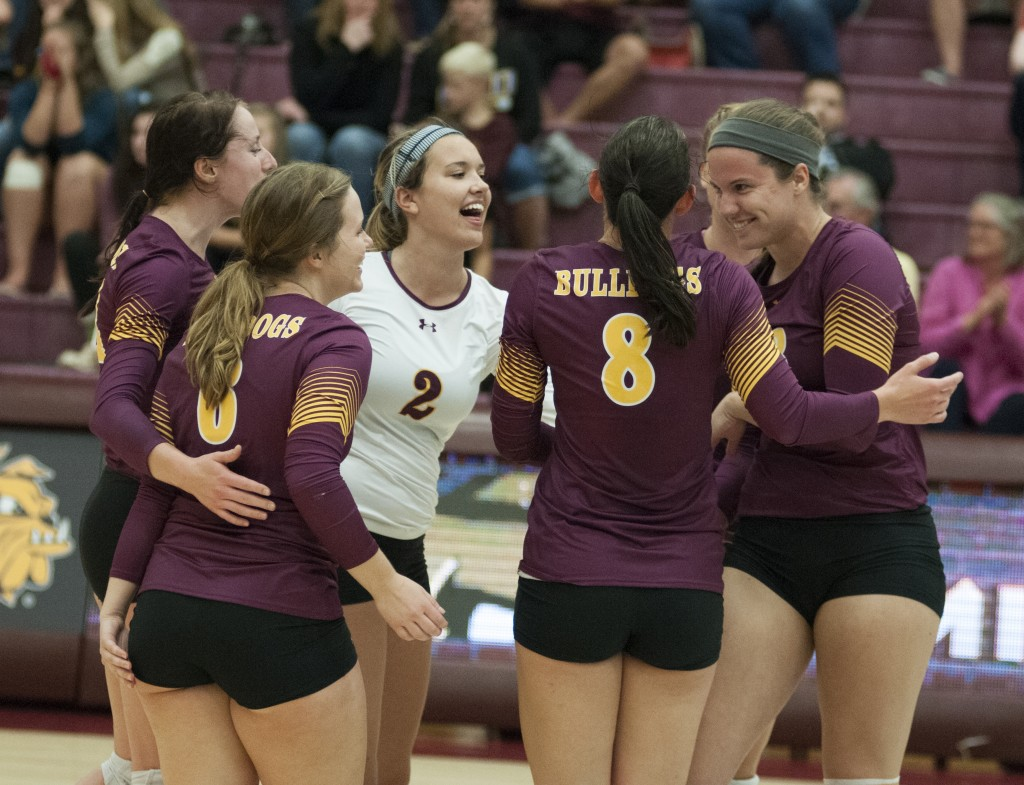 Erin Schindler (in white) celebrates a point with her teammates.
