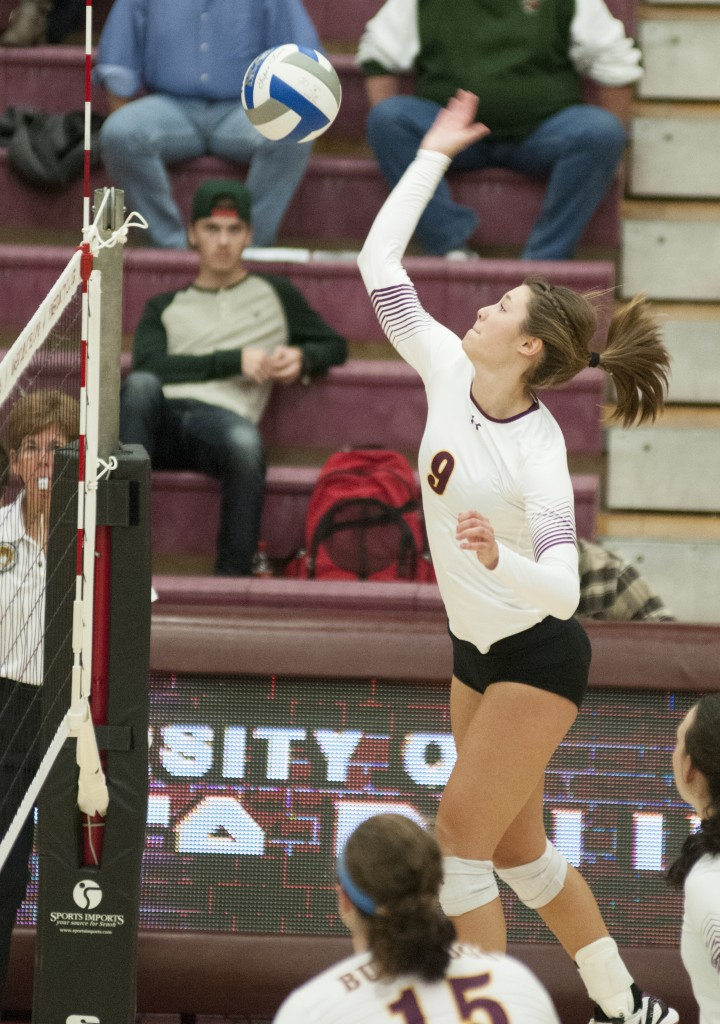 Freshman Sarah Kelly, an outside hitter, goes for a kill at Romano Gym.