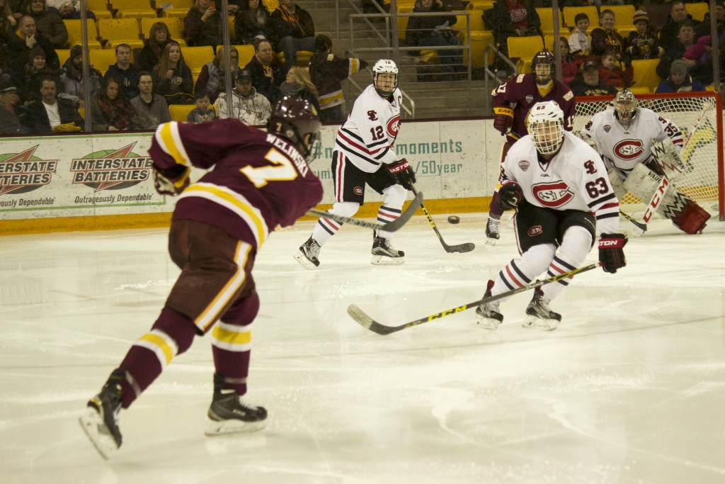 Andy Welinski takes a shot against St. Cloud State University. The senior captain leads the Bulldog defensive core in points this season with 2 goals and 9 assists. BRAD EISCHENS/STATESMAN