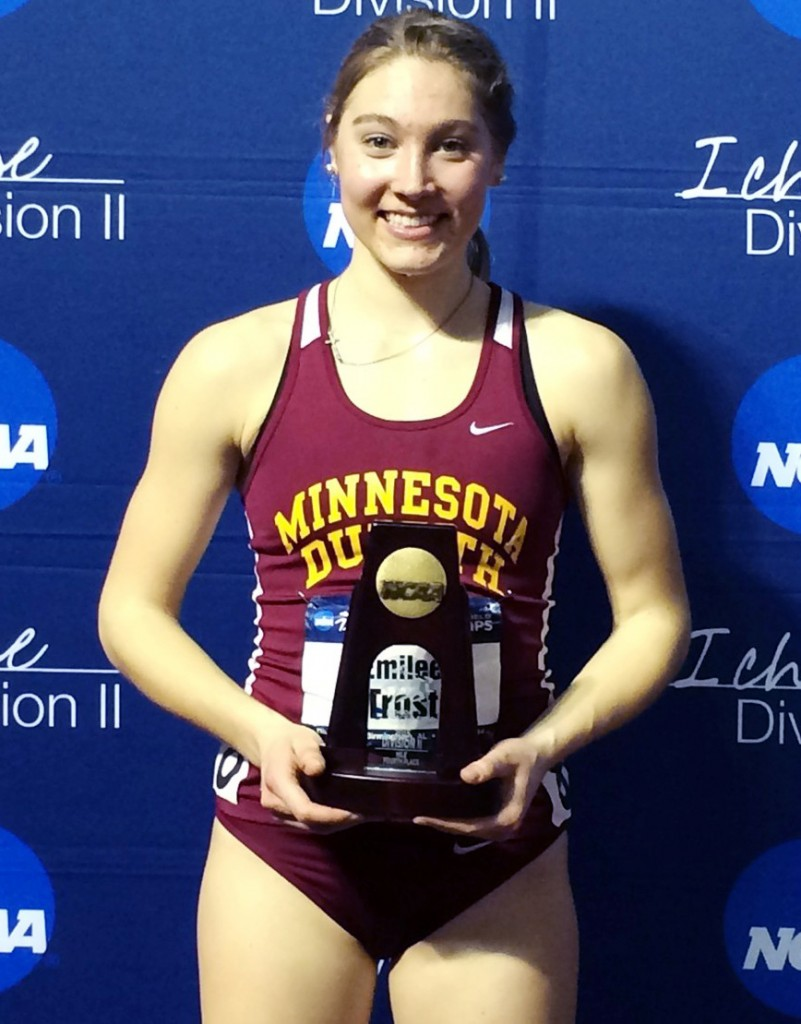 Emi Trost poses with z trophy she won after finishingNo. 4 in the nation in the mile run last spring. Her performance earned her All-American status. She also won another All-American title this past fall with the cross-country team. UMD ATHLETICS/SUBMITTED