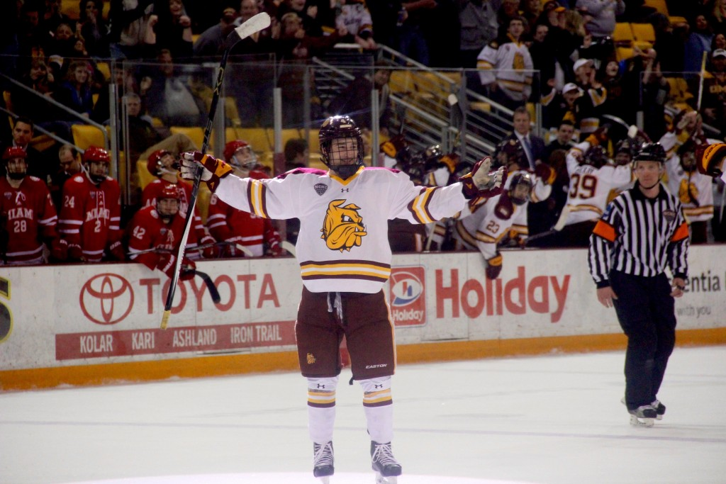 Freshman Neal Pionk celebrates after scoring the game-tying goal on a third-period power play. MADDIE GINSBERG/STATESMAN