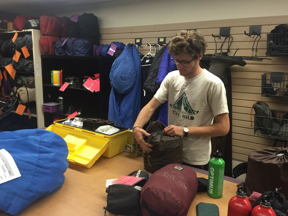 UMD Rental Center staff member Max Whitson unpacks, checks and repacks camping equipment for standard maintenance