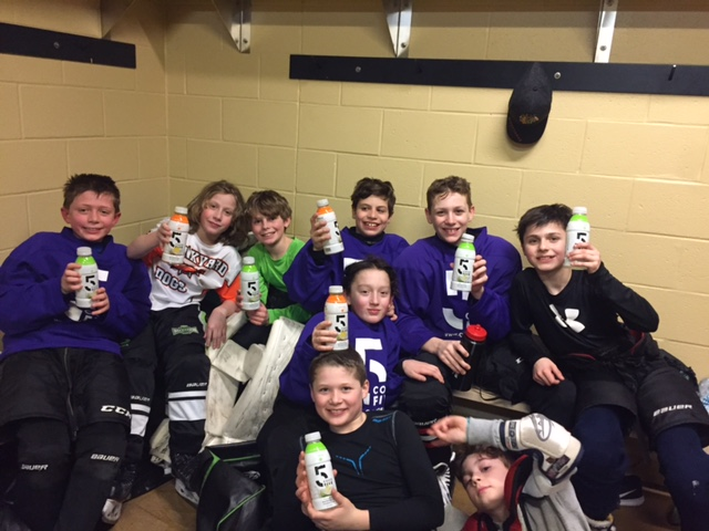Youth Hockey Players Holding COCO5.jpeg