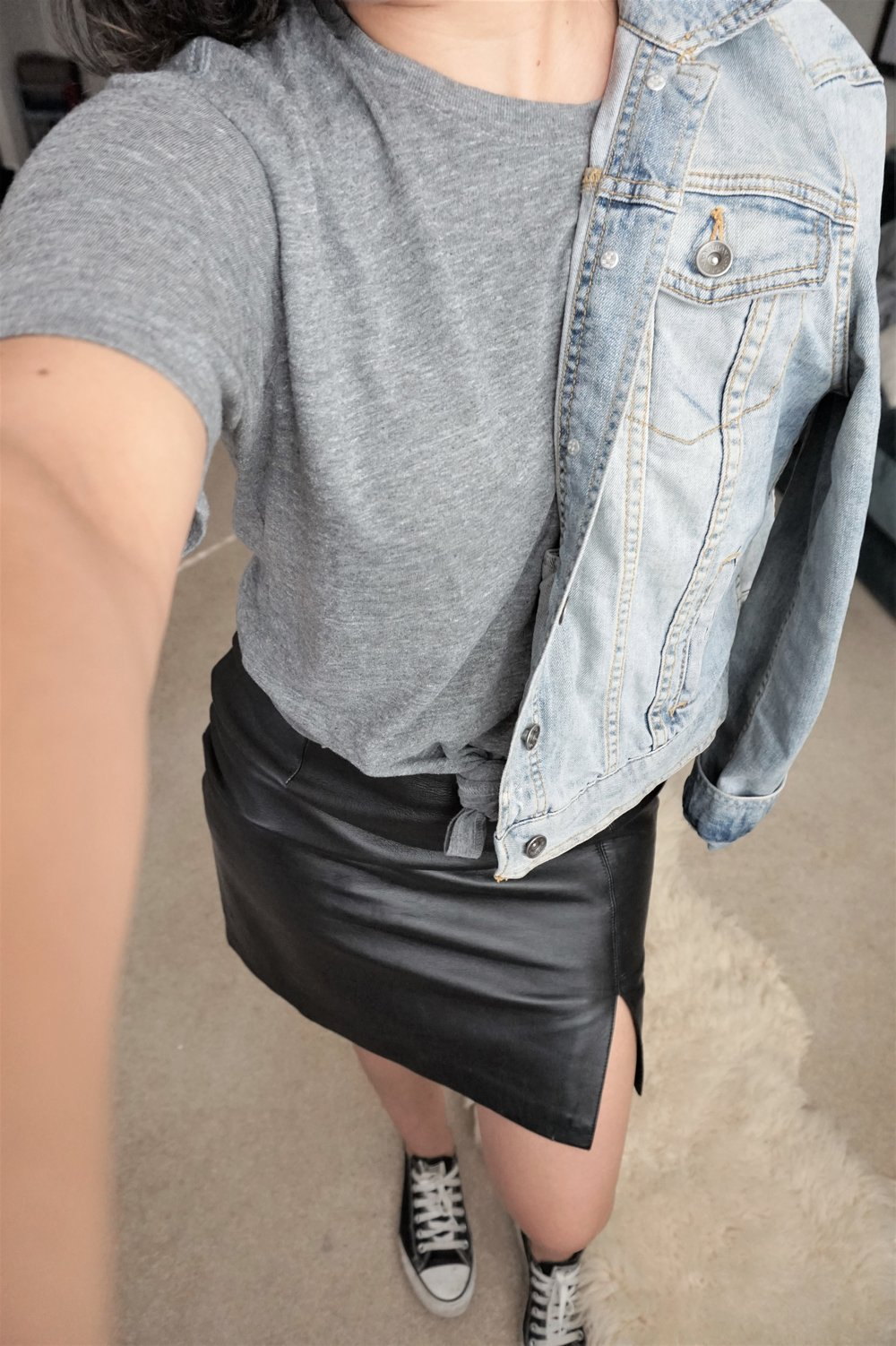 casual leather skirt denim jacket outfit