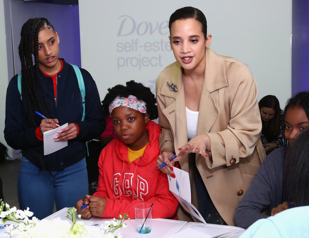 NEW YORK, NY - MARCH 06:  Actress Dascha Polanco and her daughter, Dasany, mentor local girls from the Boys and Girls Clubs of America at an empowering Dove Self-Esteem Workshop in NYC on March 6, 2018. Dascha and the Dove Self-Esteem Project are joining forces this International Women�s Day to encourage mentors to spend an #HourWithHer using confidence-building curriculum from Dove to improve a girl�s self-esteem for a lifetime. Visit Dove.com/SelfEsteem to access free, accredited educational tools and resources.  (Photo by Astrid Stawiarz/Getty Images for Dove) *** Local Caption *** Dascha Polanco, Dasany Gonzalez