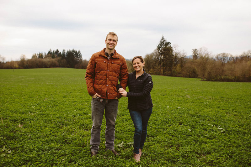 Local Flow Health Bar Owners, Brett and Heather Miller standing on their farm in Carlton, Oregon.