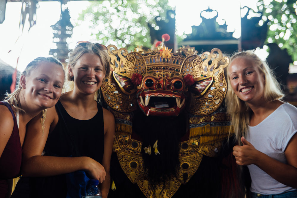 Kaja, Ingrid and Frida posing with the Barong after watching him do his traditional dance routine which represents the eternal battle between good and evil.