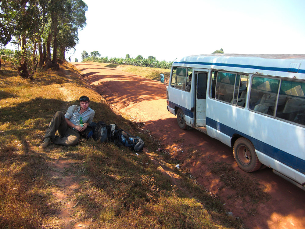 Celebrating having just crossed the border from Burundi into Tanzania with a cold drink next to another trusty local bus…