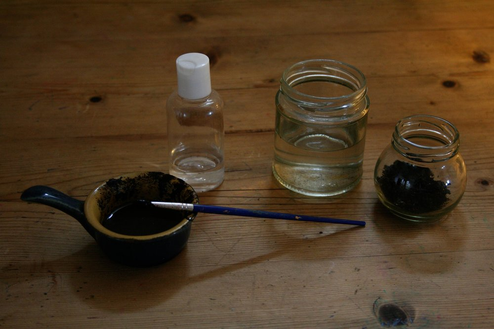 Documentation of performance involving vials of sea water, the filling of a glass fish bowl and the making of pigment using Canadian Seawater and Fenland Mud - Gudrun Filipska.