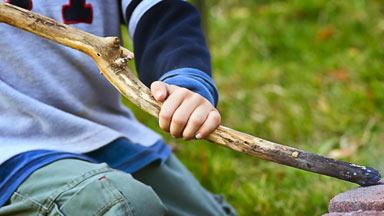 boy holding a stick