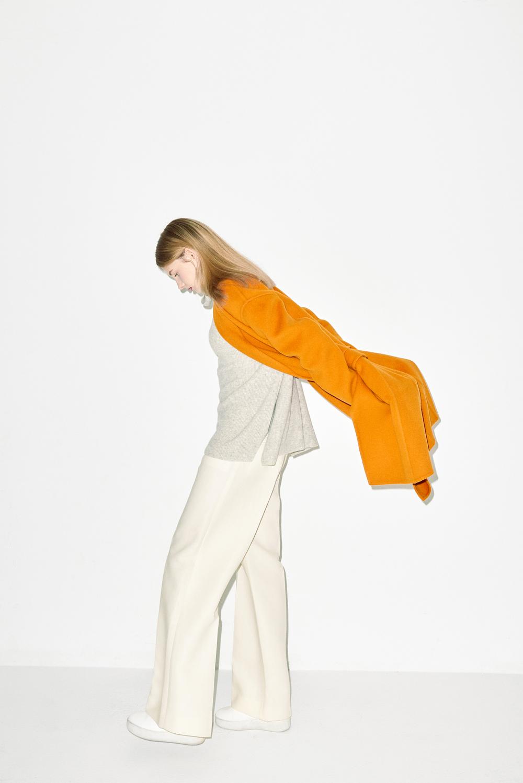 HC01. Orange handmade coat, K01. Light grey turtle neck, P03. Ivory pants