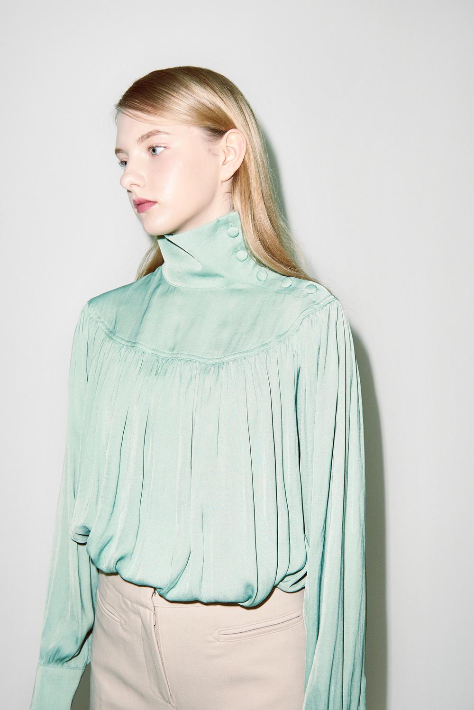 B01. Jade turtle neck blouse, P03. Light beige pants
