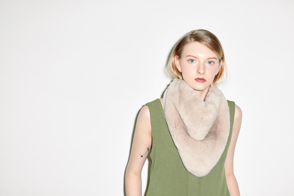 D02. Green sleeveless dress, A01. Light brown fur neck warmer