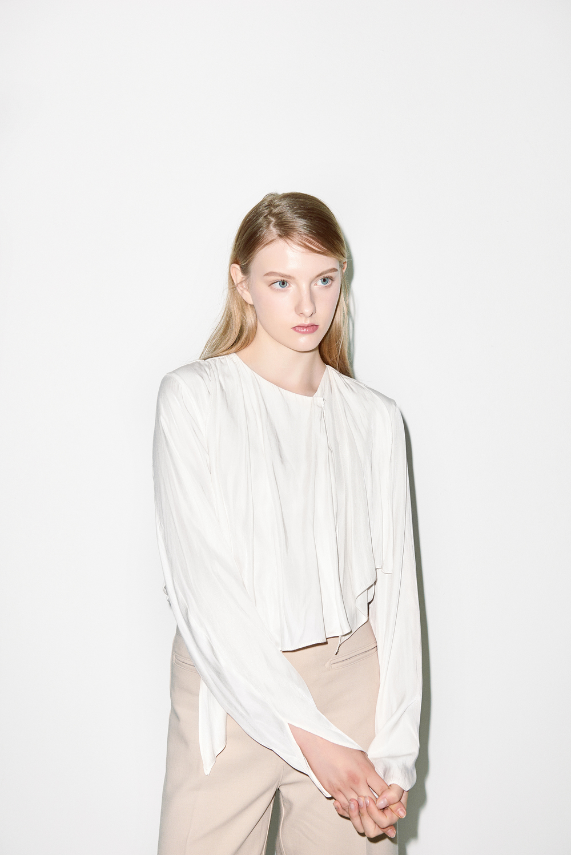 B02. Ivory frilly blouse