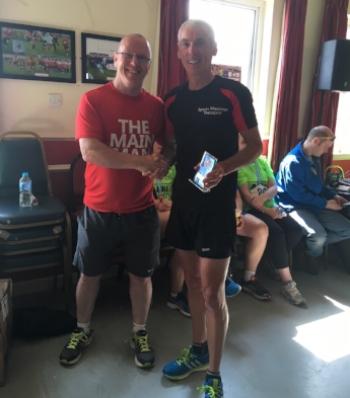 Gary receiving his trophy